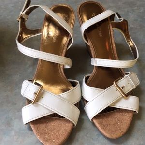 Naturalized white patent sandals